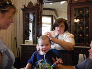 Toys and Stickers keep Jack happy during the haircut